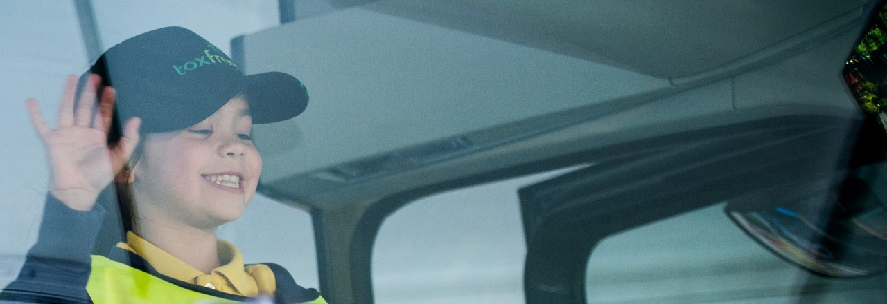 Volvo Trucks stop look wave smiling girl banner